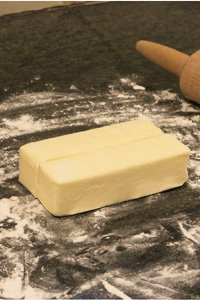 Photo 1. Place butter on floured counter.